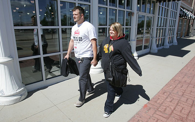 H. Rick Bamman -hbamman@shawmedia.com   Damien Savorgino (cq) and Kailee Moore, (both of Elgin) enjoy the fall weather while shopping at  Algonquin Commons Friday, Sept. 13, 2013.