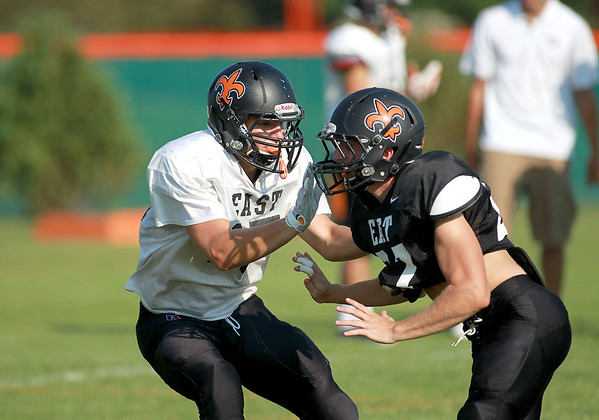 St. Charles East's Phil Hopper (left) goes up against teammate Vince Locascio during practice Tuesday afternoon.