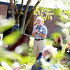 Jay Womack, director of ecological landscape design for WRD Environmental, gives the keynote address during a dedication ceremony for Western Avenue School's garden in Geneva Friday. The garden's reading circle was dedicated to former WAS teacher Mary Bencini. Womack was instrumental in planning the garden.