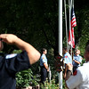 Personnel from Elburn and Countryside Fire Protection District raise two American Flags during a remembrance ceremony commemorating the 12th anniversary of the 9/11 attacks at the Elburn home of Paul Wdowicki Wednesday morning.