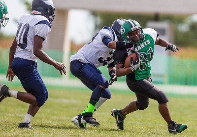 Kyle Grillot - kgrillot@shawmedia.com   Alden-Hebron junior Isaiah Johnson is tackled by Chicago Hope freshman Angelo Patterson during the third quarter of the football game against Chicago Hope at Alden-Hebron Saturday, September 14, 2013. Alden-Hebron lost to Chicago Hope 31-21.