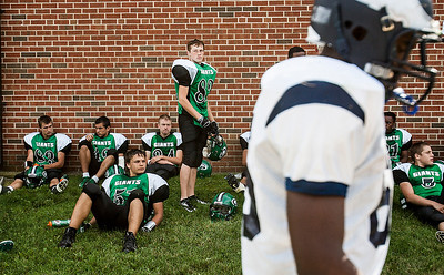 Kyle Grillot - kgrillot@shawmedia.com   Alden-Hebron junior Marcus Heaver (center) watches as the   Chicago Hope team makes their way back to the field  during half time of the football game against Chicago Hope at Alden-Hebron Saturday, September 14, 2013. Alden-Hebron lost to Chicago Hope 31-21.