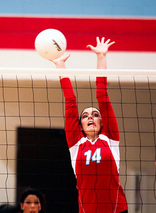 Sarah Nader -  snader@shawmedia.com Marian Central's Sarah Schaefer jumps to block a ball during Monday's volleyball match against Chicago Christian in Woodstock September 16, 2013. Marian Central was defeated, 0-2.