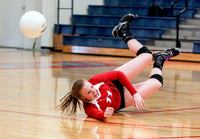 Sarah Nader -  snader@shawmedia.com Marian Central's Hannah Davis dives for the ball during Monday's volleyball match against Chicago Christian in Woodstock September 16, 2013. Marian Central was defeated, 0-2.