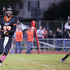 St. Charles East's Jimmy Mitchell (17) rolls out in the pocket against St. Charles North at St. Charles East High School in St. Charles, IL on Friday, September 13, 2013 (Sean King for Shaw Media)