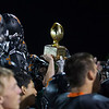 St. Charles East players raise the crosstown trophy in victory after defeating St. Charles North in overtime at St. Charles East High School in St. Charles, IL on Friday, September 13, 2013 (Sean King for Shaw Media)