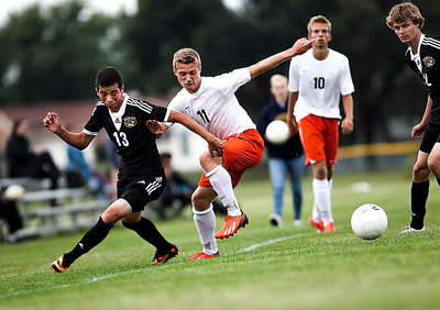 Sarah Nader -  snader@shawmedia.com Crystal Lake Central's Danilo Costa (left) and McHenry's Evan Hying run after the ball during the second half of Tuesday's soccer game in McHenry September 17, 2013.
