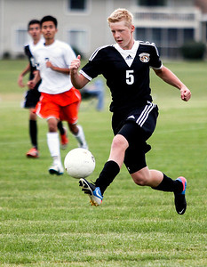 Sarah Nader -  snader@shawmedia.com Crystal Lake Central's Kyle Klusendorf brings the ball down field during the first half of Tuesday's soccer game against McHenry September 17, 2013.