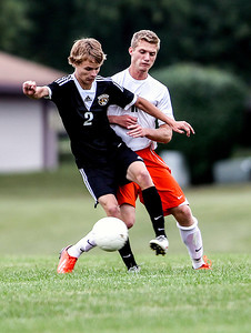 Sarah Nader -  snader@shawmedia.com Crystal Lake Central's Scott Benhart (left) is defended by McHenry's Evan Hying during the second half of Tuesday's soccer game in McHenry September 17, 2013.