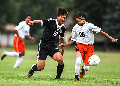 Sarah Nader -  snader@shawmedia.com Crystal Lake Central's Michael Chen (left) defends McHenry's Luis Beltran during the first half of Tuesday's soccer game in McHenry September 17, 2013.