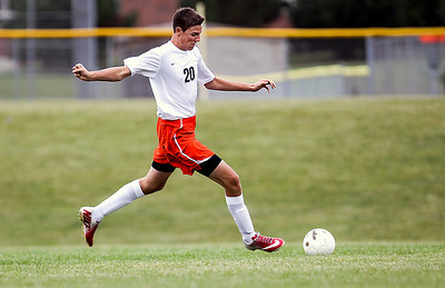 Sarah Nader -  snader@shawmedia.com McHenry's Joe Trocki brings the ball down field during the second half of Tuesday's soccer game against Crystal Lake Central in McHenry September 17, 2013.