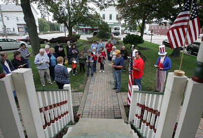 Area residents read the Constitution preamble at the Huntley Square Gazebo on Main Street during the Constitution Day program on Tuesday.  H. Rick Bamman - hbamman@shawmedia.com