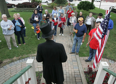 Standing on the steps of the Huntley Square Gazebo Abraham Lincoln portrayed by Gary Cooney of Huntley relates a story of the 16th President's early life. H. Rick Bamman - hbamman@shawmedia.com