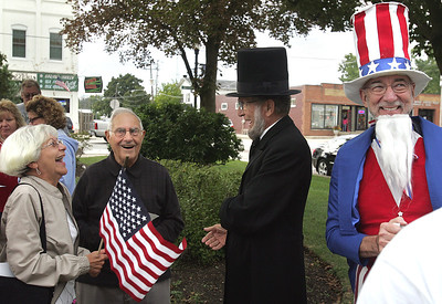 Abraham Lincoln portrayed by Gary Cooney and Jim Nelson as Uncle Sam both of Huntley share a laugh with citizens after the conclusion of the Constitution Day program at the Huntley Square Gazebo on Main Street. The Huntley Constitution Study Group meets the second and fourth Wednesday's Sept. 11 though Dec. 11. Then resumes Jan. 8 through Feb, 12, 2014 at the Hunley Area Library. H. Rick Bamman - hbamman@shawmedia.com