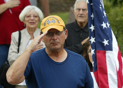 Gary Bills of Woodstock salutes during the playing of the National Anthem.  H. Rick Bamman - hbamman@shawmedia.com