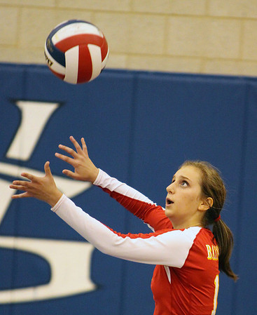 Jeff Krage – For Shaw Media<br /> Batavia's Lauren Wazio serves during Tuesday's match at Geneva High School.<br /> Geneva 9/17/13