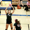 St. Charles East's Carly Jimenez sets the ball during their 25-17, 23-25, 25-22 loss to St. Charles North Tuesday night.