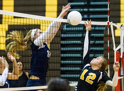Kyle Grillot - kgrillot@shawmedia.com   Cary-Grove freshman Maddy Katchen blocks Jacobs senior Mackie Truab's ball during the second period of the girls volleyball match at H. D. Jacobs High School Thursday, September 19, 2013. Cary-Grove won the match.