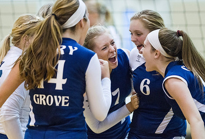 Kyle Grillot - kgrillot@shawmedia.com   Morgan Lee (7) celebrates with her team after a scored point in the first period of the girls volleyball match at H. D. Jacobs High School Thursday, September 19, 2013. Cary-Grove won the match.