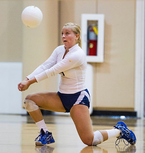 Kyle Grillot - kgrillot@shawmedia.com   Team captain Delany Beyer passes the ball during the girls volleyball match at H. D. Jacobs High School Thursday, September 19, 2013.