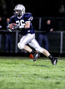 Sarah Nader- snader@shawmedia.com Cary-Grove's Talon Michaelis runs the ball during the first quarter of Friday's football game against Dundee-Crown September 20, 2013. Cary-Grove defeated Dundee-Crown, 34-0.
