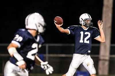 Sarah Nader- snader@shawmedia.com Cary-Groves quarterback Jason Gregoire throws a pass during the third quarter of Friday's football game against Dundee-Crown In Cary September 20, 2013. Cary-Grove defeated Dundee-Crown, 34-0.