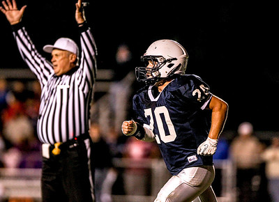 Sarah Nader- snader@shawmedia.com Cary-Grove's Matt Sutherland runs off the field after a touchdown in the first quarter of Friday's football game against Dundee-Crown September 20, 2013. Cary-Grove defeated Dundee-Crown, 34-0.