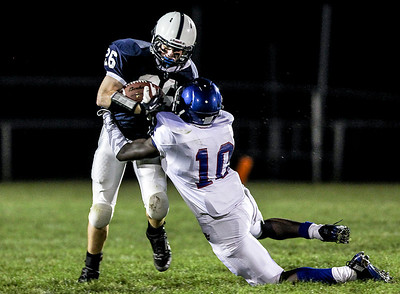 Sarah Nader- snader@shawmedia.com Cary-Grove's Talon Michaelis (left) is tackled by Dundee-Crown's Milik Dunner during the second quarter of Friday's football game in Cary September 20, 2013. Cary-Grove defeated Dundee-Crown, 34-0.