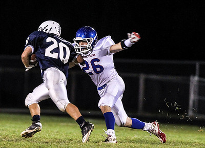 Sarah Nader- snader@shawmedia.com Cary-Grove's Matt Sutherland (left) is tackled by Dundee-Crown's Sam Franckowiak during the third quarter of Friday's football game In Cary September 20, 2013. Cary-Grove defeated Dundee-Crown, 34-0.
