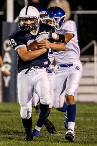 Sarah Nader- snader@shawmedia.com Cary-Grove's  Tyler Pennington runs the ball during the first quarter of Friday's football game against Dundee-Crown September 20, 2013. Cary-Grove defeated Dundee-Crown, 34-0.