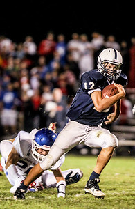 Sarah Nader- snader@shawmedia.com Cary-Groves quarterback Jason Gregoire runs a play during the fourth quarter of Friday's football game against Dundee-Crown In Cary September 20, 2013. Cary-Grove defeated Dundee-Crown, 34-0.