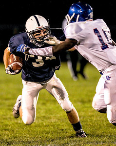 Sarah Nader- snader@shawmedia.com Cary-Grove's George Hartke (left) is tackled by Dundee-Crown's Milik Dunner during the second quarter of Friday's football game In Cary September 20, 2013. Cary-Grove defeated Dundee-Crown, 34-0.