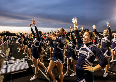 Sarah Nader- snader@shawmedia.com Cary-Grove cheerleader Natalie Terzich (right), 17, cheers with her squad before Friday's football game against Dundee-Crown In Cary September 20, 2013. Cary-Grove defeated Dundee-Crown, 34-0.