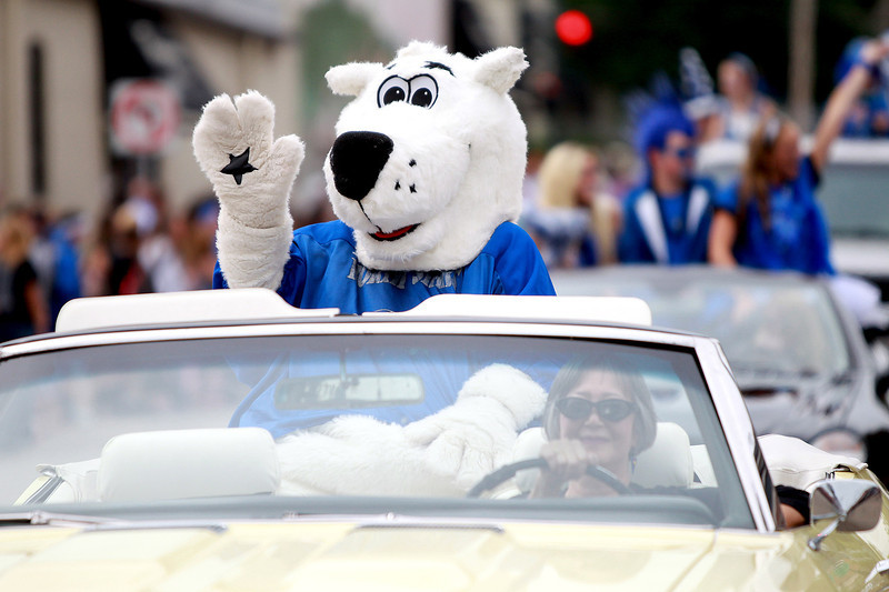 Polaris, the St. Charles North High School mascot, rides in a convertible during their annual homecoming parade on Illinois Street Friday afternoon.