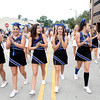 St. Charles North High School cheer leaders make their way down Illinois Street in downtown St. Charles during their annual homecoming parade Friday afternoon.