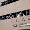 Students watch from the parking garage as the St. Charles North High School homecoming parade makes its way down Illinois Street in downtown St. Charles Friday afternoon.