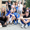 (Left to right) St. Charles North High School students Jillian Horlbeck, Nick Henry, Josh Streit and Alan Seyller watch the school's annual homecoming parade on Illinois Street Friday afternoon.