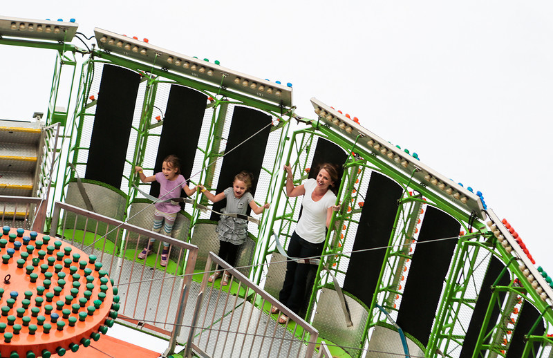 Kyle Grillot - kgrillot@shawmedia.com   Addison Smith, 5, Grace Mertel, 5, and Kelly Mertel all of Crystal Lake ride the Zero Gravity ride during the Crystal Lake Centennial Kick-Off Festival at Three Oaks Recreation Area Friday, September 20, 2013. The festival is part of the celebration of the 100th birthday since Crystal Lake's incorporation as a city, and will continue until Sunday at 6 p.m.