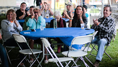 Kyle Grillot - kgrillot@shawmedia.com   The crowd applauds the Jimmy Nick and Don't Tell Mama band during the Crystal Lake Centennial Kick-Off Festival at Three Oaks Recreation Area Friday, September 20, 2013. The festival is part of the celebration of the 100th birthday since Crystal Lake's incorporation as a city, and will continue until Sunday at 6 p.m.