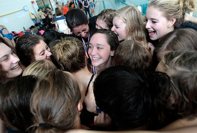 Kyle Grillot kgrillot@shawmedia.com  The Jacobs team celebrates after winning the Woodstock North girls swimming invite Saturday, September 21, 2013.