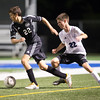 Kaneland's  Michael Meisenger (left) dribbles past Geneva's defender Ethan Nims (22) at Geneva High School in Geneva, IL on Monday, September 23, 2013 (Sean King for Shaw Media)
