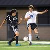 Kaneland defender Esteban Ochoa (24) and Geneva's Igor Honore (19) play the ball at Geneva High School in Geneva, IL on Monday, September 23, 2013 (Sean King for Shaw Media)