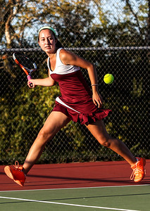 Sarah Nader- snader@shawmedia.com Prairie Ridge's Callie Schmit returns a ball while competing in a singles match against Crystal Lake South's Julia Thome in Crystal Lake September 26, 2013.