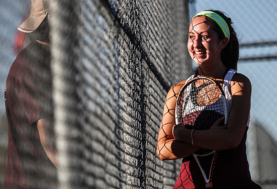 Sarah Nader- snader@shawmedia.com Prairie Ridge's Callie Schmit talks with her coach in-between tennis matches at Thursday's tournament against Crystal Lake South in Crystal Lake September 26, 2013.