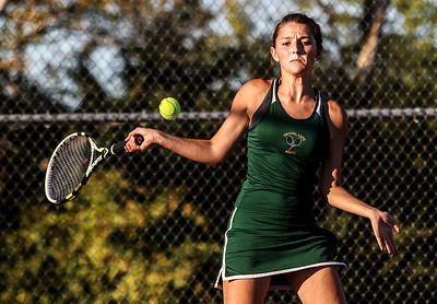 Sarah Nader- snader@shawmedia.com Crystal Lake South's Julia Thome returns a ball while competing in a singles match against Prairie Ridge's Callie Schmit in Crystal Lake September 26, 2013.