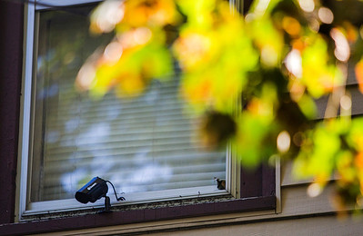 Kyle Grillot - kgrillot@shawmedia.com   Drug dealers are commonly known to install surveillance systems on their home. This camera is one of several seen outside a suspects home on Jackson Street in Woodstock Thursday September 26, 2013. At least 35 officers from Woodstock, Lake in the Hills, McHenry Sheriffs department, and the U.S. Marshall's Great Lakes Regional Fugitive Task Force went to 20 different locations around McHenry county Thursday morning to arrest suspects with drug-related felony warrants. These types of criminal roundups are clustered together in order to use these resources in a cost effective manner. Today, 16 of the 20 warrants ended in arrests, and at least 10 will now have additional charges based on the recovery of paraphernalia and other charges.