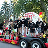 Batavia High School soccer players make their way down Wilson Street for the school's annual homecoming parade Wednesday evening.