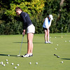 St. Charles North senior Carly Hudon, a recent transfer from Sycamore, practices on the putting green with her team at Pheasant Run Golf Course Wednesday afternoon.