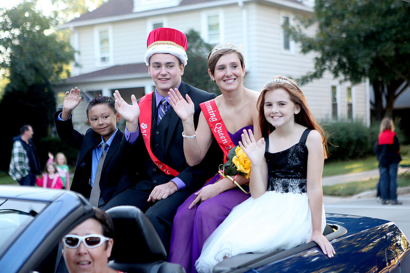 King Donovan Kilker and Queen Taylor Falk are joined by Oscar Collins, 7, and Abby McReynolds, 10, during the Batavia High School homecoming parade on Wilson Street Wednesday evening.