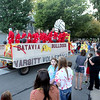 Crowds wave as the Batavia High School varsity volleyball team travel  down Wilson Street for the school's annual homecoming parade Wednesday evening.